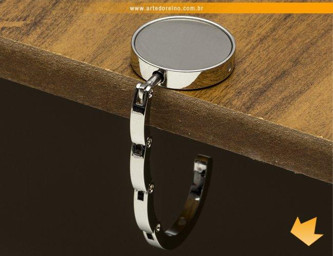 http://www.artedoreino.com.br/content/interfaces/cms/userfiles/produtos/brinde-suporte-de-bolsa-feminino-personalizado-arte-do-reino-brindes-10006-561.jpg